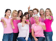 Cheerful women posing and wearing pink for breast cancer Royalty Free Stock Image
