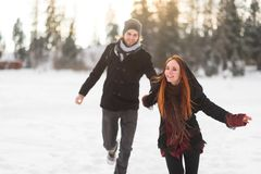 Redhead woman leading her man to explore mountains Stock Photography