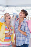 Cheerful women with shopping bags Stock Photos