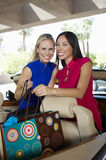 Cheerful Women With Shopping Bags In Convertible Royalty Free Stock Photo