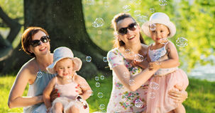 Cheerful women with their cute children Stock Photos
