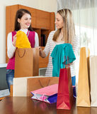 Cheerful women together looking purchases Royalty Free Stock Image