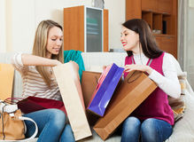 Cheerful women together looking purchases Stock Photography
