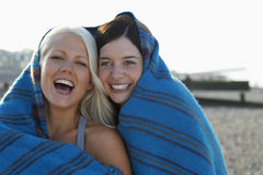 Cheerful Women Wrapped In Blanket Stock Photography