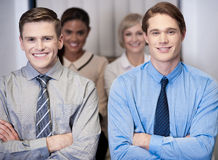 Cheerful work team posing, arms crossed. Royalty Free Stock Photo