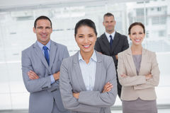 Cheerful work team posing crossing arms Stock Image