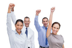 Cheerful work team posing with hands up. On white background Royalty Free Stock Photo