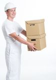 Cheerful worker with carton boxes Stock Image