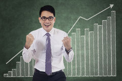 Cheerful worker and financial graph Royalty Free Stock Photos