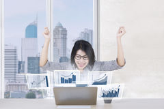 Cheerful worker with profit graph Royalty Free Stock Image