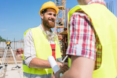 Cheerful worker shaking the hand of an architect at the beginnin Stock Photo