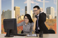 Cheerful workers celebrating their achievement Royalty Free Stock Photography