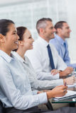 Cheerful workmates attending presentation Stock Photo
