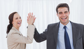 Cheerful workmates doing high five Stock Image
