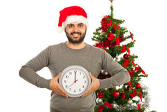 Cheerful Xmas man holding big clock Royalty Free Stock Photos