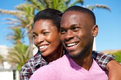 Cheerful young african american couple smiling outdoors royalty free stock images