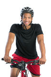 Cheerful Young African American Male Riding Bike Stock Image