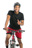 Cheerful Young African American Male Riding Bike Stock Images