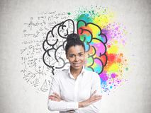 Cheerful young African American woman, brain Stock Photos