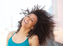 Cheerful young african american woman smiling Stock Photos