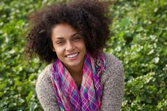 Cheerful young african american woman smiling outdoors Stock Images
