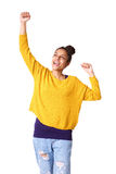 Cheerful young african woman with arms raised Stock Images