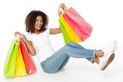 Cheerful young african woman holding shopping bags. Stock Photos