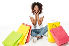 Cheerful young african woman holding shopping bags. Stock Images