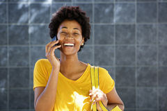 Cheerful young african woman making a phone call Royalty Free Stock Image
