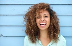 Cheerful young african woman smiling Royalty Free Stock Photos