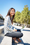 Cheerful young asian girl working on laptop Stock Photos