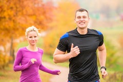 Cheerful young athletes jogging  morning Royalty Free Stock Image