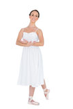 Cheerful Young Ballet Dancer Posing With Leg Back Royalty Free Stock Photography