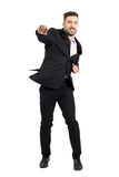 Cheerful young bearded business man jumping excited with clenched fists. Royalty Free Stock Photo