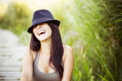 Cheerful woman with hat Stock Photo