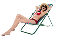 Cheerful young bikini model relaxing and having fun Royalty Free Stock Image