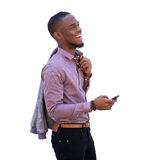Cheerful young black guy holding cell phone Stock Photography