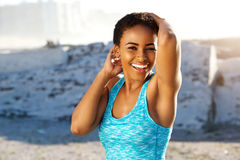 Cheerful young black sports woman smiling outside Stock Images
