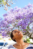 Cheerful young black woman looking up outside in spring Royalty Free Stock Photo