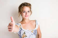 Cheerful young blond woman thumbs up. Stock Photography