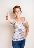 Cheerful young blond woman thumbs up. Stock Photos
