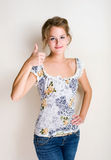 Cheerful young blond woman thumbs up. Royalty Free Stock Photography