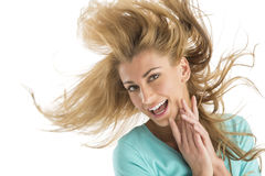 Cheerful Young Blond Woman Tossing Hair Royalty Free Stock Images