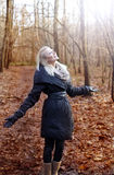Cheerful young blonde girl in forest. Royalty Free Stock Image