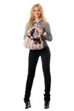 Cheerful young blonde with a handbag Royalty Free Stock Photography