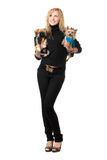 Cheerful young blonde posing with two dogs Royalty Free Stock Images