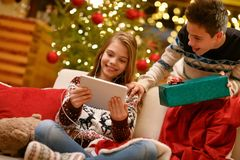Boy and girl enjoying in music Christmas gifts Royalty Free Stock Image