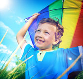 Cheerful Young Boy Playing Kite Outdoors Concept Stock Image