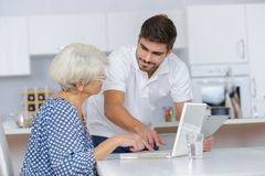 Cheerful young boy sharing time with old senior woman Royalty Free Stock Photography