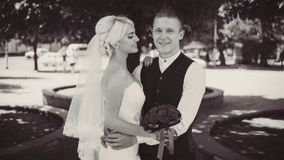 Cheerful young bride smiles when she stands with her husband. Married couple. Husband and wife. Close-up. black and white stock photos